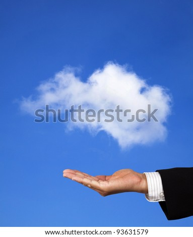 cloud computing concept. hand of businessman hold a cloud - stock photo