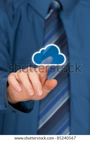 Cloud computing concept. Mans hand click on cloud icon ahead. Selective focused on forefinger. - stock photo