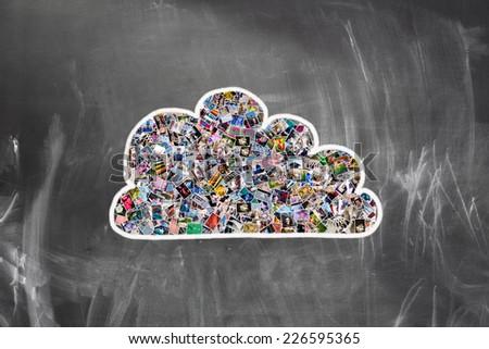 Cloud computing concept. Many photos inside a cloud on blackboard  - stock photo