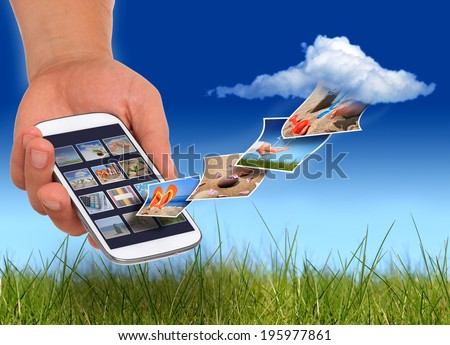Cloud computing concept. Mini tablet in hand. - stock photo