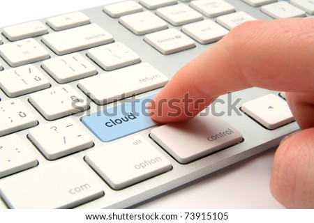 Cloud computing concept - modernized computer keyboard with cloud keypad - stock photo