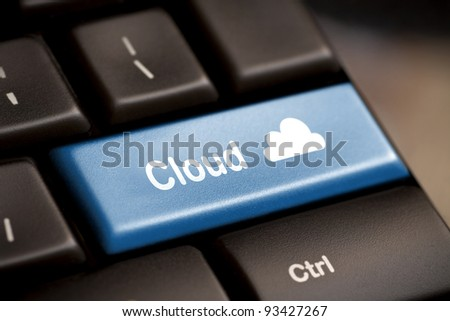 Cloud computing concept showing cloud icon on computer key. - stock photo