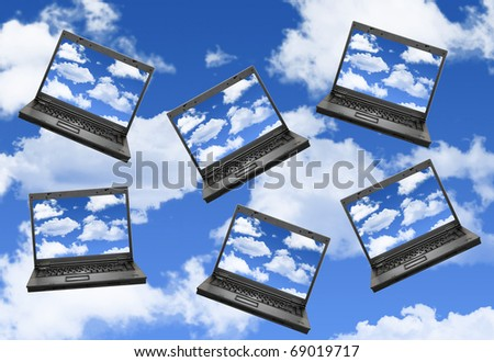 Cloud computing concept with laptops in the sky - stock photo