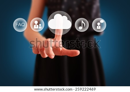 Cloud computing concept. Woman click on cloud icon ahead. Selective focused on finger and cloud - stock photo