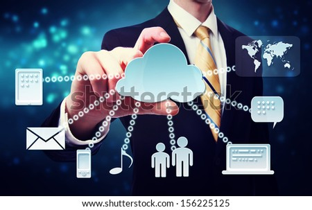Cloud computing connection concept with business man on a blue technology background - stock photo