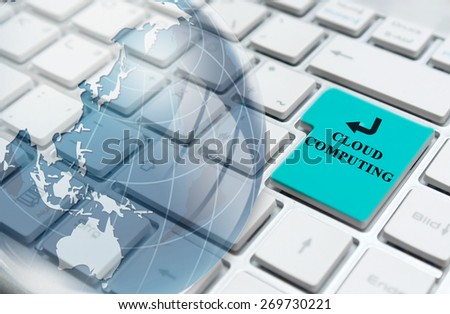 Cloud computing enter key and glass globe over white computer keyboard  - stock photo