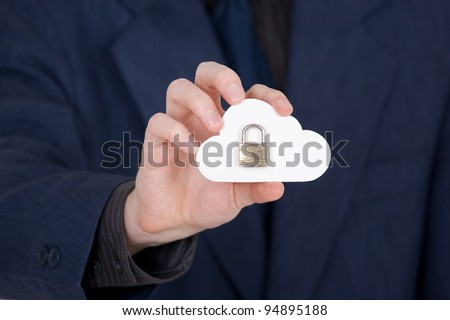 Cloud computing security concept. Hand giving secure cloud locked with padlock. - stock photo