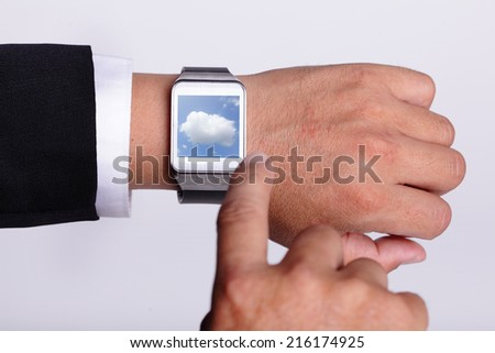 Cloud computing tech with smart watch concept - stock photo
