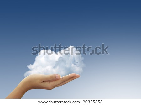 Cloud in woman hands on blue sky, the concept of natural care. - stock photo