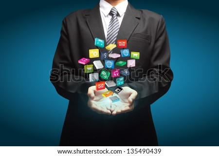 Cloud of colorful application icons in the hands of businessmen - stock photo
