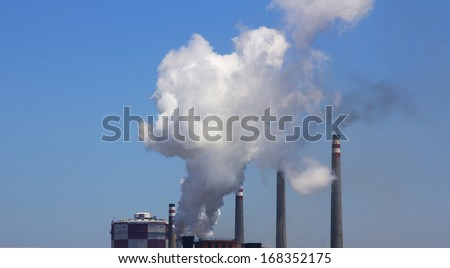 cloud of smoke and polution in a factory - stock photo