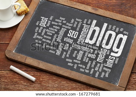 cloud of words or tags related to blogging and blog design on a  vintage slate blackboard with a chalk and  cup of coffee - stock photo