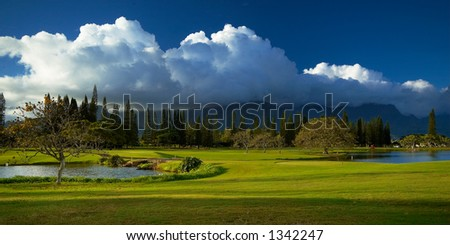 Cloud over golf course on Kauai Hawaii. More with keyword Series001E. - stock photo