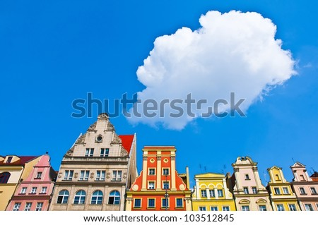 Cloud over Wroclaw's Market Square tenements - stock photo