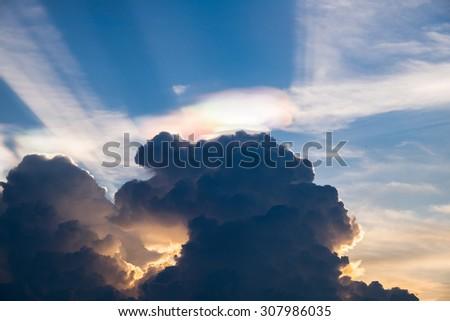 Cloud rainbow color weird blue sky shine beam - stock photo