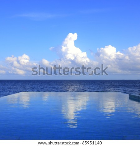 cloud reflections on the infinity pool