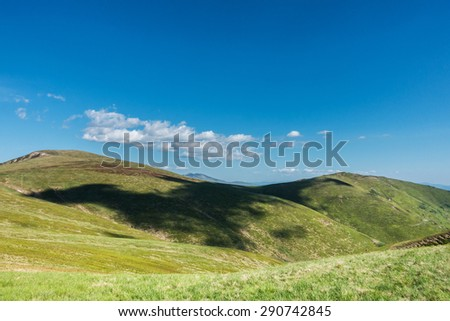 Cloud shadows on the green fields of spring mountains - Svydovets range, Carpathians, West Ukraine - stock photo