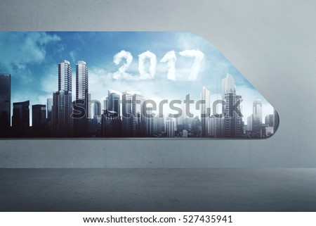 Cloud shape 2017 number on the sky, looking from modern window. Happy new year concept