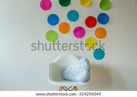 Cloud shaped pillow in cozy child's room - stock photo