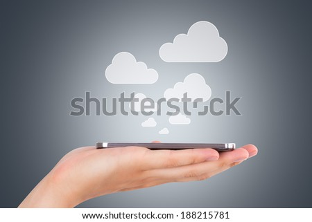 Cloud sync concept, hand holding smart phone with icons. - stock photo