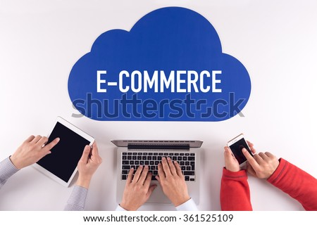 Cloud technology with a word E-COMMERCE - stock photo