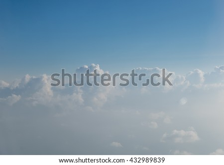 Cloud texture wallpaper. View of blue sky and cloudy field from airplane window.  - stock photo