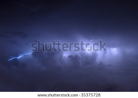 Cloud to Cloud Lightning Strike Before Rain Showers - stock photo