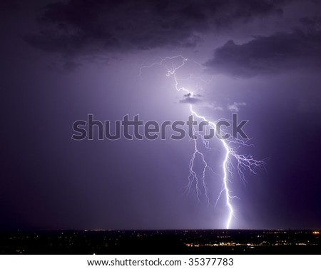 Cloud-to-ground lightning strike over northwest Tucson.
