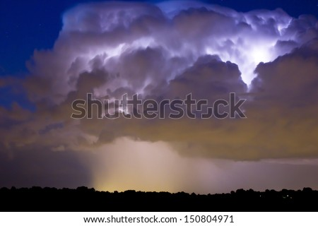 Cloudburst with lightning  - stock photo