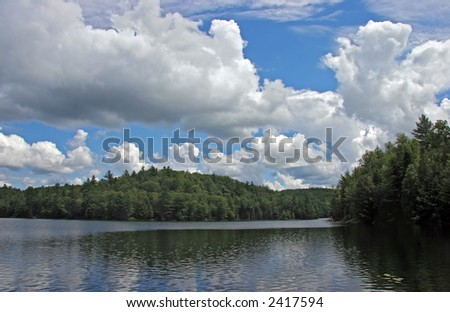 Clouds above the lake - stock photo
