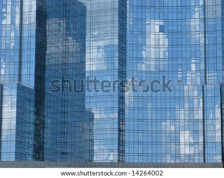 Clouds across the skyscrapers - stock photo