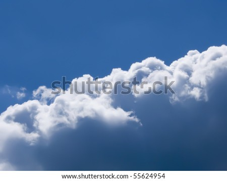 clouds against the dark blue sky - stock photo