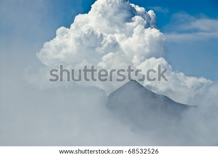 Clouds and ash mix together as Volcan Fuego erupts in Guatemala, as seen from the top of nearby Volcan Agua. Elevation 12,350. - stock photo