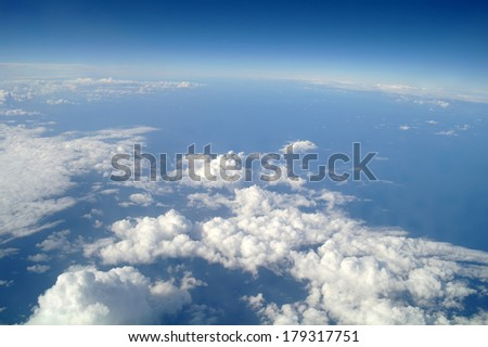 clouds and blue sky seen from plane - stock photo