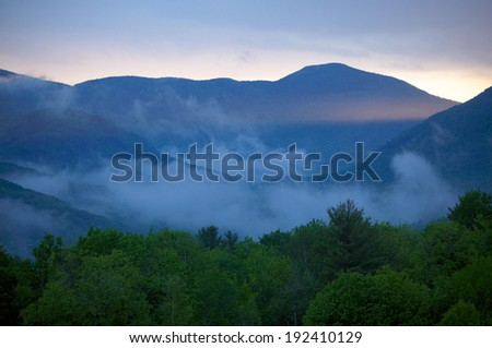 Clouds and colorful sunset over Nebraska Valley in Stowe, Vermont., USA - stock photo