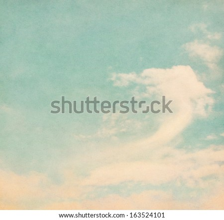 Clouds and fog on a textured, vintage paper background.  Image displays a pleasing grain texture at 100 percent.