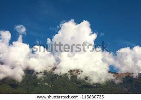 Clouds and hill.