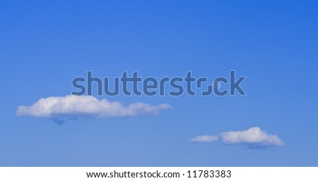 Clouds and moon on a blue sky in a late afternoon. - stock photo