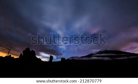 clouds and star trails above volcano Teide and Roques de Garcia