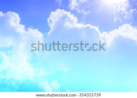 clouds and sun flare background with a pastel colored. - stock photo