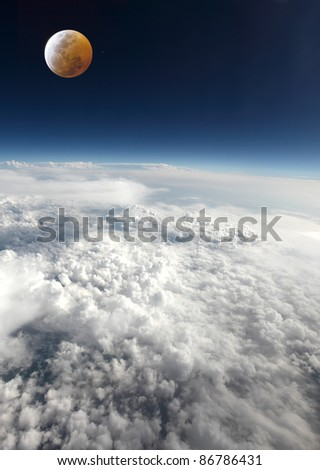 Clouds and the moon,at the time of a lunar eclipse