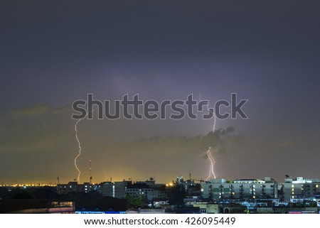 Clouds and thunder lightnings and storm over city