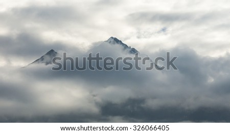 Clouds around a mountain in the Austrian Alps.
