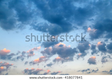 Clouds at sunset, bright colorful sunset - stock photo