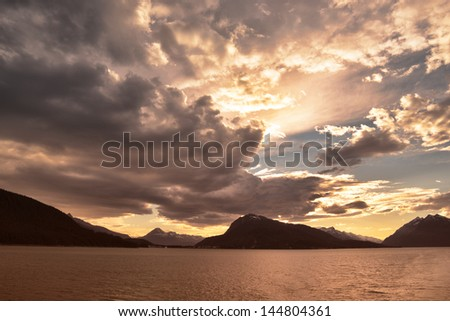 Clouds at sunset from the ferry to Juneau in the Inside Passage in Southeast Alaska. - stock photo
