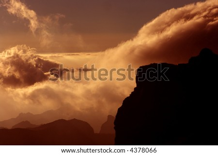 clouds at the mountains at the sunset, in tenerife island - stock photo