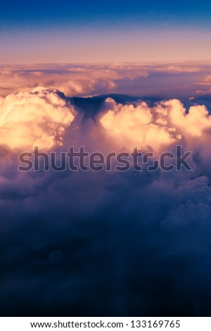 Clouds. bright morning dawn in the sky. sunset with a height of 10 000 km. Top view. leaving day. Bottom night, another day on top, lit the departing sun. - stock photo