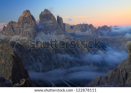 Clouds filling the valley after sunset, Dolomite Alps, Italy - stock photo