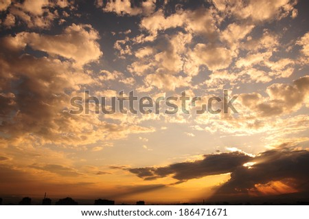 Clouds floating across the sky at sunset - stock photo