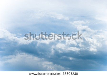 Clouds flowing through a summer sky - stock photo
